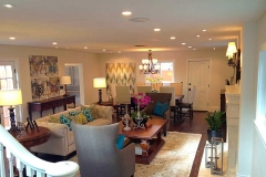 Family-room-LED-can-lights,-hanging-fixture,-wall-sconces